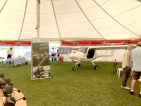Light aircraft inside marquee