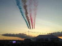 Red Arrows flying over marquee